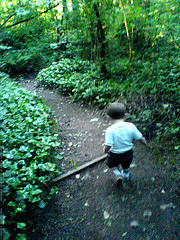 A kid running on a trail