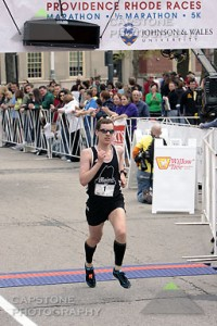 Blaine Moore crossing the Finish Line