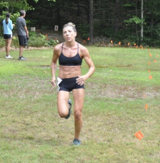 woman sprinting to finish